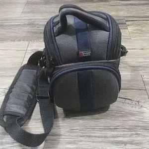Camera holder/bag with inside zipper pockets